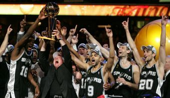 CLEVELAND - JUNE 14:  San Antonio Spurs owner Peter Holt celebrates with his team after defeating the Cleveland Cavaliers in Game Four of the NBA Finals at the Quicken Loans Arena on June 14, 2007 in Cleveland, Ohio. NOTE TO USER: User expressly acknowledges and agrees that, by downloading and/or using this Photograph, user is consenting to the terms and conditions of the Getty Images License Agreement. Mandatory Copyright Notice: Copyright 2007 NBAE (Photo by David Liam Kyle/NBAE via Getty Images)